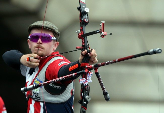 NOTTINGHAM, ENGLAND - MAY 29: Patrick Huston of Britain shoots during the Men's Recurve Gold medal team match at the European Archery Championship on May 29, 2016 in Nottingham, England. (Photo by Nigel Roddis/Getty Images)