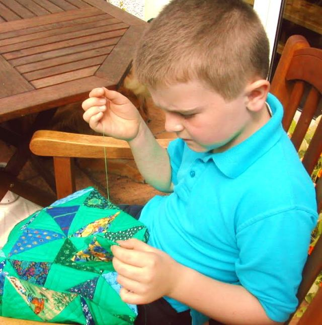 Sewing with his Granny